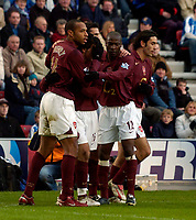 Photo: Jed Wee.<br />Wigan Athletic v Arsenal. The Barclays Premiership.<br />19/11/2005.<br />Arsenal celebrate with goalscorer Thierry Henry.