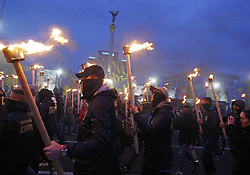 October 14, 2017 - Kiev, Ukraine - Ukrainian activists and supporters of Ukrainian nationalist parties hold torches as Ukrainians celebrate the 75th anniversary of Ukrainian Insurgent Army (UPA) creation in center of Kiev, Ukraine, on 14 October 2017. The UPA acted mainly in the west of Ukraine until the beginning of the 1950s and had more than 40,000 soldiers in its strongest period. UPA fought for Ukrainian independence against the Red army and the Nazis during the World War II. (Credit Image: © Serg Glovny via ZUMA Wire)