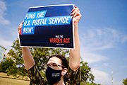 22 AUGUST 2020 - DES MOINES, IOWA: KATE WISHMAN from Des Moines, stands on the median of 2nd Ave in front of the main US Post Office in Des Moines during a rally in support of the USPS. About 35 people picketed the main US Post Office in Des Moines Saturday protesting changes made to the Postal Service by the Trump Administration. Nationally, there has been concern that changes to the Postal Service will hurt citizens' ability to vote by mail in the 2020 presidential election.        PHOTO BY JACK KURTZ