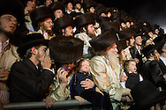 A young boy fells asleep late at night during the Lag BaOmer celebrations in the orthodox distric of Mea Shearim