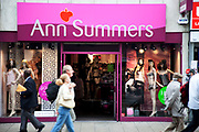 Shoppers pass by Ann Summers adult store on Oxford Street in Central London. This is a busy shopping area full of all the main high street chain stores.