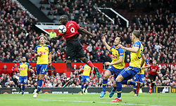 Manchester United's Romelu Lukaku (centre) attempts a shot on goal during the Premier League match at Old Trafford, Manchester.