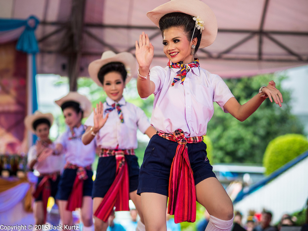 09 AUGUST 2015 - BANGKOK, THAILAND:  Performers at a talent show to honor Queen Sirikit of Thailand. Sirikit, born Mom Rajawongse Sirikit Kitiyakara on 12 August 1932, is the queen consort of Bhumibol Adulyadej, King (Rama IX) of Thailand. She met Bhumibol in Paris, where her father was the Thai ambassador. They married in 1950, shortly before Bhumibol's coronation. Sirikit was appointed Queen Regent in 1956. Sirikit produced one son and three daughters. As the consort of the king who is the world's longest-reigning head of state, she is also the world's longest-serving consort of a monarch. Sirikit suffered a stroke on 21 July 2012 and has since refrained from public appearances. Her birthday is celebrated as Mother's Day in Thailand.     PHOTO BY JACK KURTZ