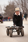 Amish boy rides a wagon during the Annual Mud Sale to support the Fire Department  in Gordonville, PA.