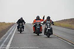 American Iron Magazine publisher Buzz Kanter (In orange suit) riding his 1936 Harley-Davidson VLH beside Cris Sommer Simmons (in grey suit) on her 1934 Harley-Davidson VD during Stage 13 (257 miles) of the Motorcycle Cannonball Cross-Country Endurance Run, which on this day ran from Elko, NV to Meridian, Idaho, USA. Thursday, September 18, 2014.  Photography ©2014 Michael Lichter.