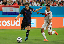 March 23, 2018 - Miami Gardens, Florida, USA - Croatia midfielder Luka Modric (10) sets up to kick the ball past Peru defender Yoshimar Yotun (19) during a FIFA World Cup 2018 preparation match between the Peru National Soccer Team and the Croatia National Soccer Team at the Hard Rock Stadium in Miami Gardens, Florida. (Credit Image: © Mario Houben via ZUMA Wire)