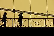 Anglers on suspension bridge.