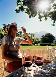 Woman tasting wine under oak tree at Boschendal wine estate (Credit Image: © Axiom/ZUMApress.com)