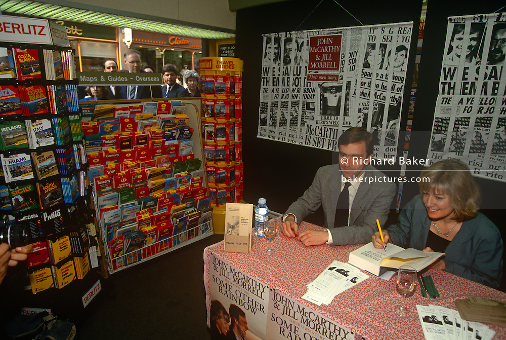 Former Beirut hostage John McCarthy and his former partner Jill Morrell sign copies of their book 'Some Other Rainbow' in the summer of 1993, London England.