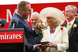 © Licensed to London News Pictures. 06/11/2012. Camilla, Duchess of Cornwall presents the Melbourne Cup trophy to winning owner Nick Williams after Green Moon won the Emirates Melbourne Cup during the Emirates Melbourne Cup at the Flemington Racecourse, Melbourne. Photo credit : Asanka Brendon Ratnayake/LNP