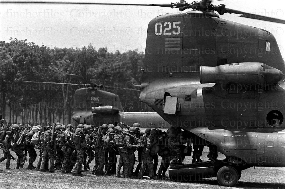South Vietnamese army soldiers load on to  Boeing CH-47 Chinook, helicopters during the evacuation of Xuan Loc. Xuan Loc was the last major battle of the Vietnam War fought between 9th and 21st April 1975. Photographed by Terry Fincher.