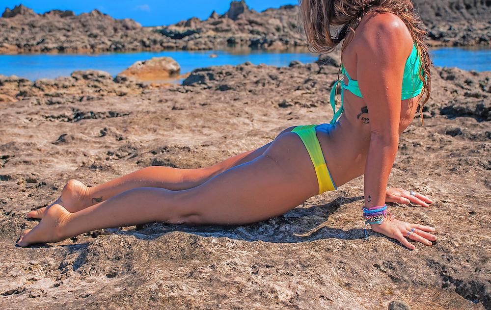 woman doing yoga in a bikini on a beach in hawaii<br /> www.naiabikinis.com<br /> model Lisa Sochocki