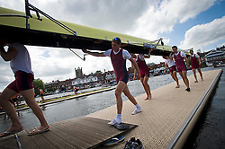 © London News Pictures. 29/06/2012.  Henley-on-Thames, UK.  A rowing team leaving the water following a race on day 3 of Henley Royal Regatta on the River Thames in Henley on Thames, Oxfordshire on June 29, 2012. Photo credit: Ben Cawthra/LNP