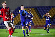 AFC Wimbledon defender Steve Seddon (42) with hands over mouth during the EFL Sky Bet League 1 match between AFC Wimbledon and Crewe Alexandra at Plough Lane, London, United Kingdom on 19 December 2020.