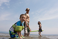 David, Suzanne, Wyatt and Tess Howes enjoy a perfect summers' day at Ellacoya State Beach on Friday.  (Karen Bobotas/for the Laconia Daily Sun)