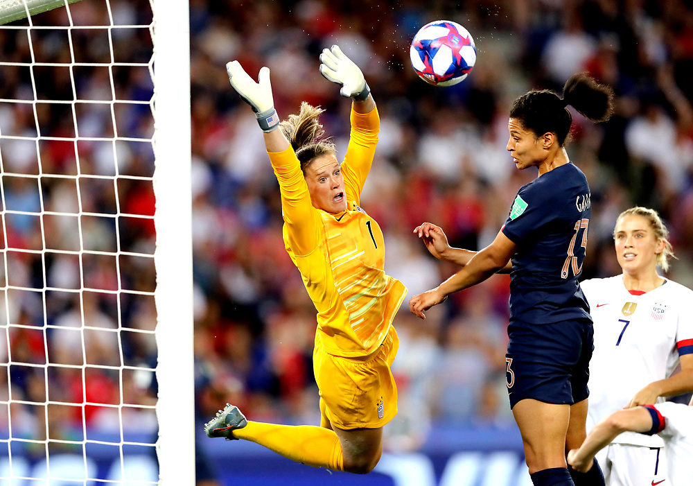 PARIS, FRANCE - JUNE 28:  Alyssa Naeher of the USA battles for possession with Valerie Gauvin of France during the 2019 FIFA Women's World Cup France Quarter Final match between France and USA at Parc des Princes on June 28, 2019 in Paris, France. (Photo by Elsa/Getty Images)