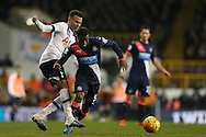 Dele Alli of Tottenham Hotspur tackles Georginio Wijnaldum of Newcastle United. Barclays Premier league match, Tottenham Hotspur v Newcastle Utd at White Hart Lane in London on Sunday 13th December 2015.<br /> pic by John Patrick Fletcher, Andrew Orchard sports photography.