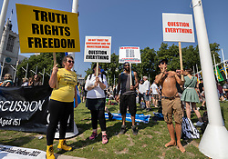© Licensed to London News Pictures. 19/07/2021. London, UK. Protesters gather in Parliament Square on Freedom Day. All covid regulations in England are being scrapped from today even though infections and hospitalisations are on the increase. Photo credit: Peter Macdiarmid/LNP