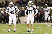 McNeil's quarterback Hayden Cooper (11) and linebacker Matthew Zebrowski (42)  watch for the signals Thursday against Cedar Ridge at Kelly Reeves Athletic Complex. (LOURDES M SHOAF for  Round Rock Leader)