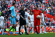 Robbie Fowler of Liverpool legends team (r) sticks up his two fingers as he gets ready to take a penalty which the Liverpool fans wanted Steven Gerrard to take.  Liverpool Legends  v Real Madrid Legends, Charity match for the LFC Foundation at the Anfield stadium in Liverpool, Merseyside on Saturday 25th March 2017.<br /> pic by Chris Stading, Andrew Orchard sports photography.