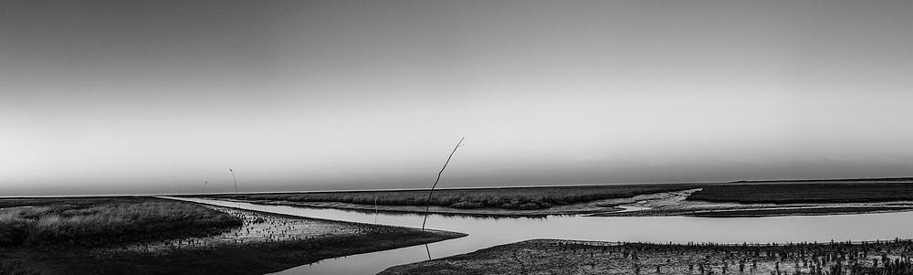 Nederland, Groningen, Het Hogeland, 15-02-2019; Noordpolderzijl met vaargeul naar de Waddenzee.<br /> Sea harbour with channel to the Wadden Sea.<br /> <br /> Onderdeel Gigapanorama (montage).<br /> copyright © 2019 foto/photo Siebe Swart