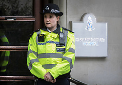 © Licensed to London News Pictures. 08/04/2018. London, UK. A police officer stands at the front door as The Duke of Edinburgh spends a 5th day in the King Edward VII Hospital as he recovers from a hip operation. Photo credit: Peter Macdiarmid/LNP