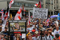 © Licensed to London News Pictures. 03/08/2019. London, UK. Supporters of Stephen Yaxley-Lennon, known as Tommy Robinson demonstrates in central London demanding to free him. Last month Tommy Robinson was given a nine-month prison sentence at Old Bailey after he was found guilty of contempt of court. Photo credit: Dinendra Haria/LNP