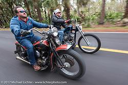 Matt McMannus (L) riding his 1941 Harley-Davidson Knucklehead model E (more rare than the EL) beside Bo Hatzoge on an Eric Stein built 1974 custom Harley-Davidson Shovelhead in Tomoka State Park during Daytona Beach Bike Week. FL. USA. Tuesday, March 14, 2017. Photography ©2017 Michael Lichter.