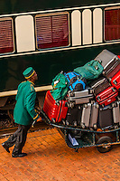 Porter loading luggage to the Rovos Rail luxury train for the journey across South Africa from Pretoria to Cape Town, Rovos Rail Station, Capital Park, Pretoria (Tshwane), South Africa.
