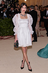 Alexa Chung walking the red carpet at The Metropolitan Museum of Art Costume Institute Benefit celebrating the opening of Heavenly Bodies : Fashion and the Catholic Imagination held at The Metropolitan Museum of Art  in New York, NY, on May 7, 2018. (Photo by Anthony Behar/Sipa USA)