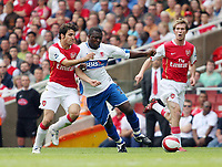 Photo: Chris Ratcliffe.<br />Arsenal v Middlesbrough. The Barclays Premiership. 09/09/2006.<br />Francesc Fabregas (L) of Arsenal and Yakubu of Boro clash as Alexander Hleb looks on in the background.