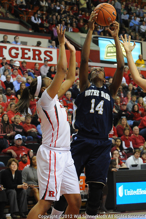 Notre Dame Fighting Irish forward Devereaux Peters (14) rebounds the ball away from Rutgers Scarlet Knights guard/forward Betnijah Laney (44) during first half NCAA Big East women's basketball action between Notre Dame and Rutgers at the Louis Brown Athletic Center. Notre Dame leads 40-23 at halftime.