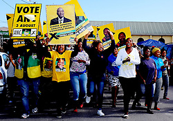 supporters of the African National Congress (ANC) party celebrate as they seek voters to support their party in Masiphumelele near Fish Hoek, Cape Town during the 2016 local government elections held across South Africa on the 3rd August 2016<br /> <br /> Photo by - Ron Gaunt / RealTime Images