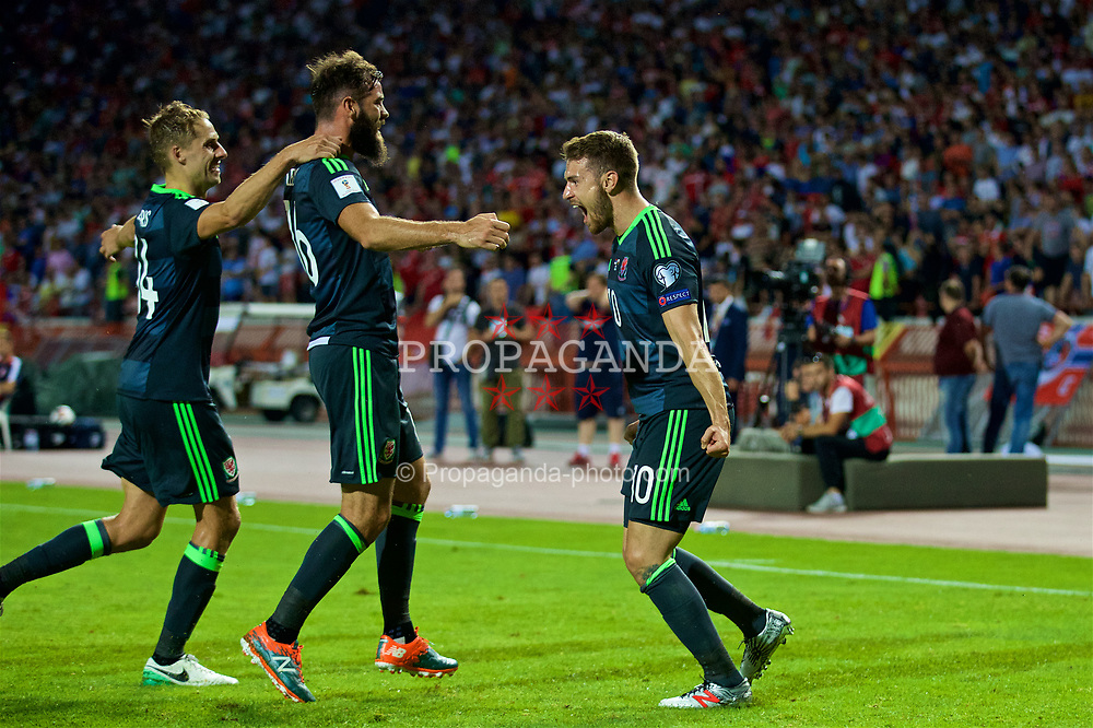 BELGRADE, SERBIA - Sunday, June 11, 2017: Wales' Aaron Ramsey celebrates scoring the opening goal from the penalty spot with team-mates David Edwards and Joe Ledley during the 2018 FIFA World Cup Qualifying Group D match between Wales and Serbia at the Red Star Stadium. (Pic by David Rawcliffe/Propaganda)