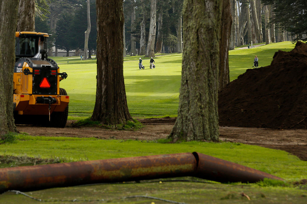 The damaged practice range as golfers nearby play on the course at TPC Harding Park Golf Club on Tuesday, Jan. 29, 2019, in San Francisco, Calif. The range sustained severe damage in the recent storms.
