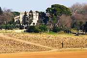 The vineyard and building of Chateau la Nerthe owned by Cafe Richard in Chateauneuf-du-Pape, Vaucluse, Rhone, Provence, France