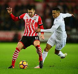 Dusan Tadic of Southampton shields the ball from Martin Olsson of Swansea City - Mandatory by-line: Alex James/JMP - 31/01/2017 - FOOTBALL - Liberty Stadium - Swansea, England - Swansea City v Southampton - Premier League
