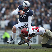 NEW HAVEN, CONNECTICUT - NOVEMBER 18: Jordan Carey #15 of Yale challenged by Tanner Lee #36 of Harvard during the Yale V Harvard, Ivy League Football match at the Yale Bowl. Yale won the game 24-3 to win their first outright league title since 1980. The game was the 134th meeting between Harvard and Yale, a historic rivalry that dates back to 1875. New Haven, Connecticut. 18th November 2017. (Photo by Tim Clayton/Corbis via Getty Images)
