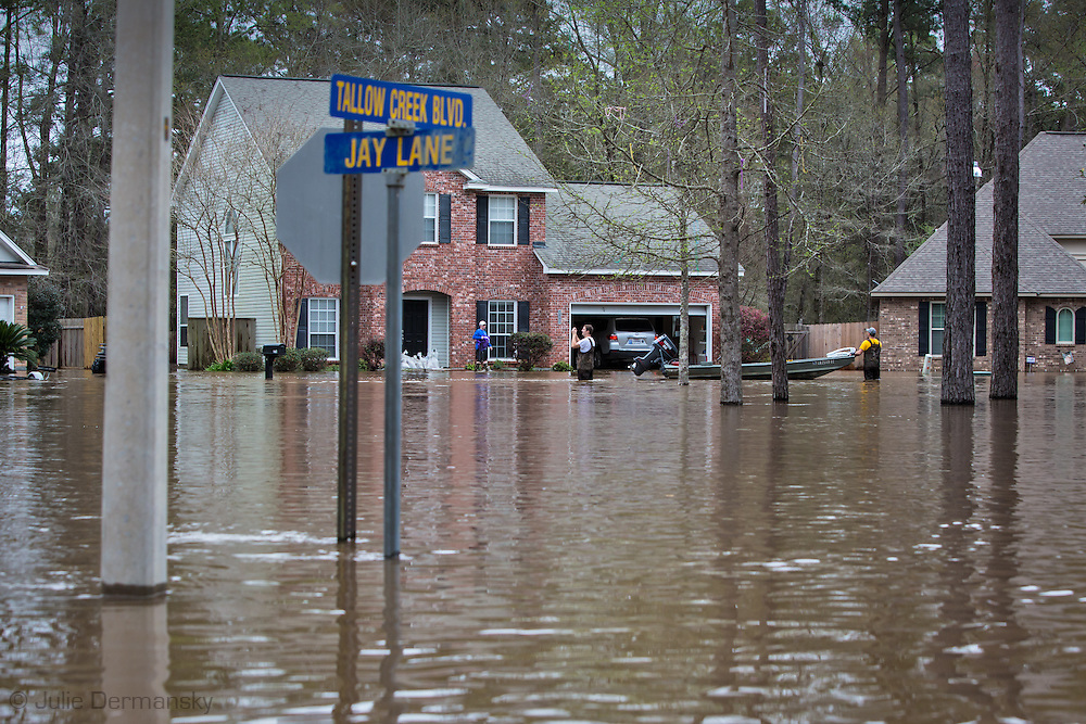 Covington Louisiana, March, 12, 2016,  Resdients in Tallow Creek subdivision survey the floodwaters that continued to rise on Saterday afternoon..14 inches of rain fell in less than 24 hours, after three days of intermittent rain, causing flash floods. The Tchefuncte River and Bogue Falaya River<br />  crested on Saturday morning but the flood event continued into the night for those in Tallow Creek.
