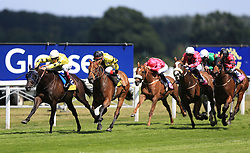 Arch Villain (left) ridden by Gavin Lerena goes onto win The Dubai Duty Free Shergar Cup Stayers ahead of Sea Of Heaven (second left) ridden by Kenichi Ikezoe in second during the Dubai Duty Free Shergar Cup day at Ascot Racecourse.