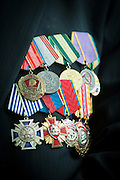 Veteran Albert Ivanovich's medals at the BAM (Baikal-Amur Mainline) railway museum, Severobaikalsk. Siberia, Russia