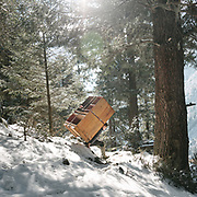 A man carrying furniture up to the village. On the trek going from Laya village to the beginning of the drivable road.