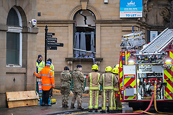 © Licensed to London News Pictures. 07/02/2019. Batley UK. The Fire Brigade, Army Bomb disposal & Gas workers asses the damage after a suspected gas explosion in Batley. At least five people have been hurt in a suspected gas explosion at a two storey building which is a block of converted flats on Hick Lane in Batley, Yorkshire  Photo credit: Andrew McCaren/LNP
