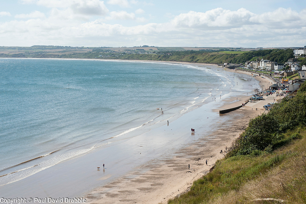 View from the cliff top north of Filey across the sandy beaches and blue sea of Filey Bay towards Flambrough Head
