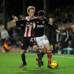Bristol City's Greg Cunningham is challenged by Brentford's George Saville - Photo mandatory by-line: Dougie Allward/JMP - Tel: Mobile: 07966 386802 28/01/2014 - SPORT - FOOTBALL - Griffin Park - Brentford - Brentford v Bristol City - Sky Bet League One