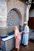 Moorish-style wall fountain, Place Nejjarine, Fes el-Bali (Old Fes), Fes, Morocco.