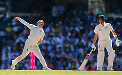 England's Mason Crane bowls as Australia's Steve Smith looks on during day two of the Ashes Test match at Sydney Cricket Ground.