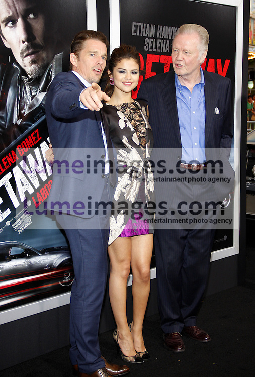 Jon Voight, Ethan Hawke and Selena Gomez at the Los Angeles premiere of Getaway held at the Regency Village Theatre in Westwood, USA on August 26, 2013.