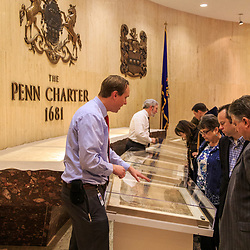 Visitors looking at the Penn Charter granting Pennsylvania by King Charles II on display inside the state museum in Harrisburg, PA.