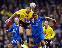 Photograph: Scott Heavey.<br /> Watford v Chelsea. FA Cup Third Round. 03/01/2004.<br /> Sean Dyche beats Adrian Mutu in the air